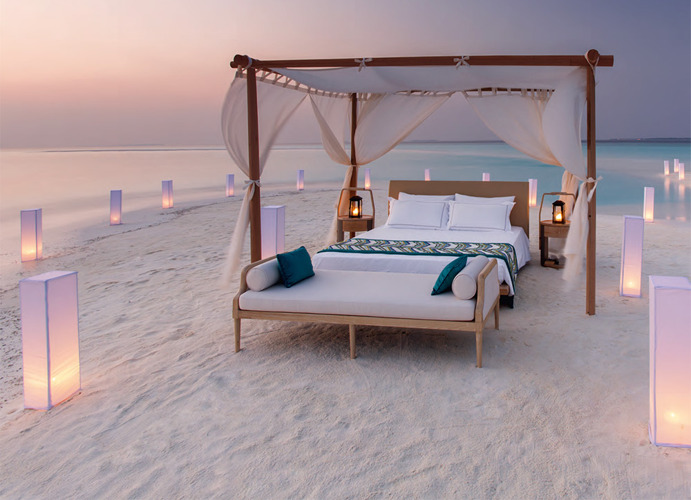 Romantic four-poster bed at the beach
